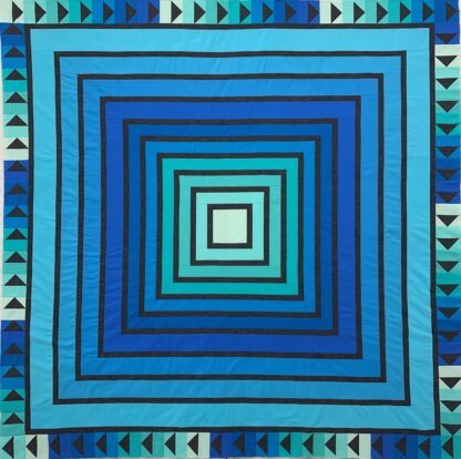 blue log style cabin quilt with grey in between each color