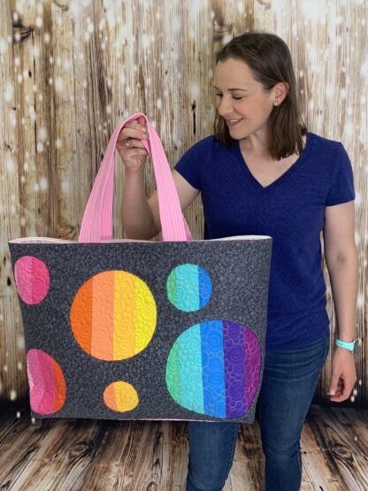 Joanna holding up Sunshine tote