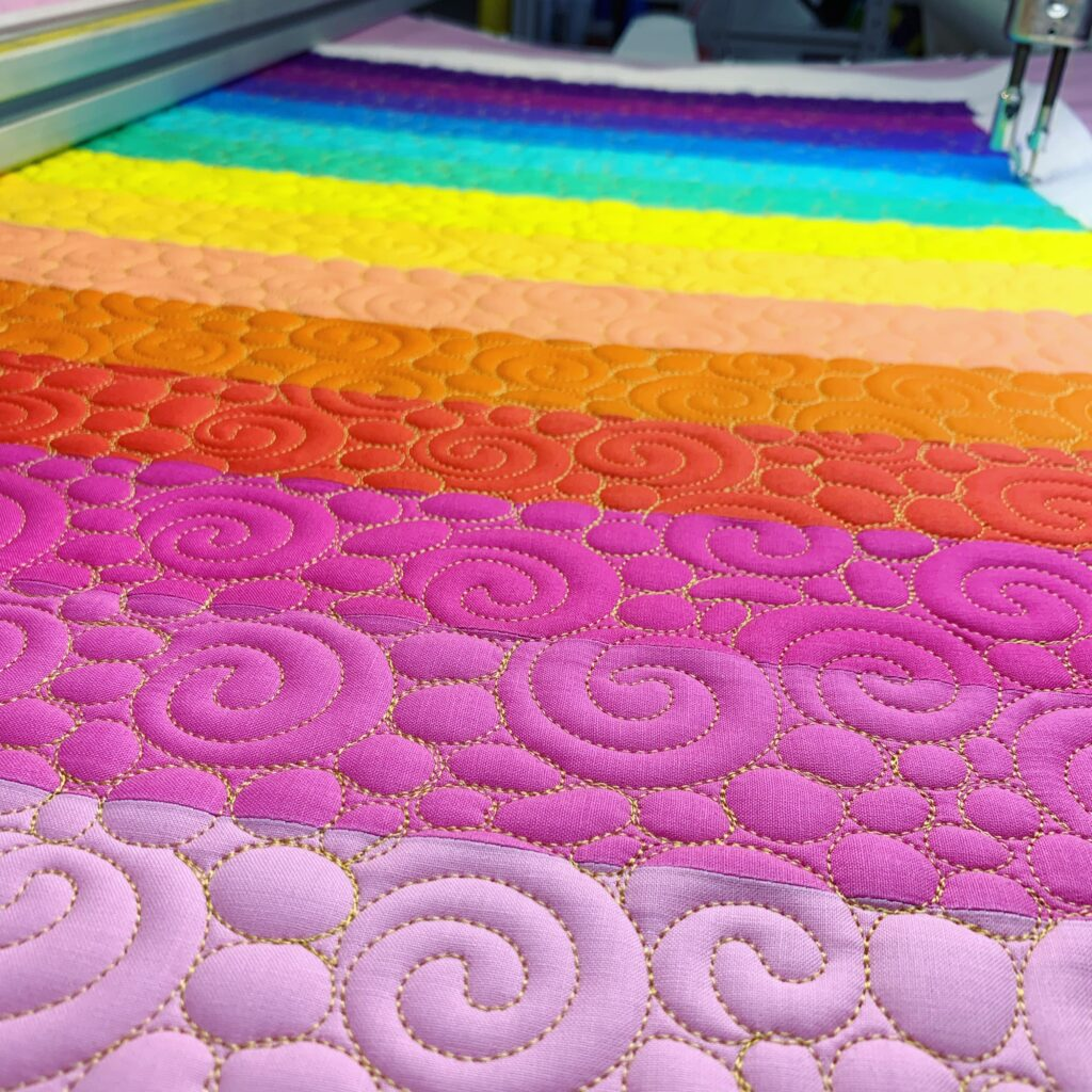 quilting the rainbow panel for the Sunshine Tote