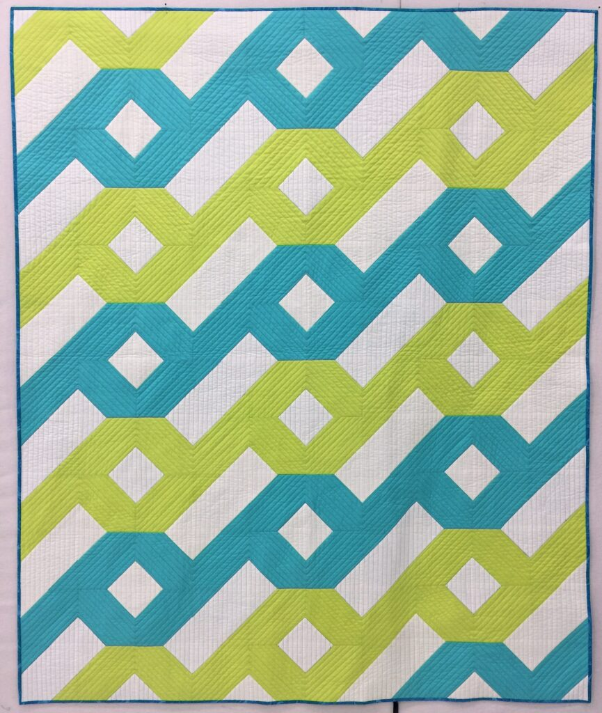 green and blue version of hurricane quilt